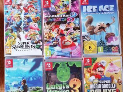 Nintendo switch lite + carcasă + 8 jocuri (vezi fo
